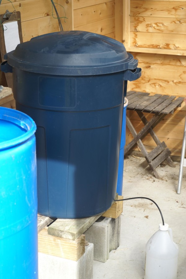 A 32-gallon bokashi composter in a greenhouse.